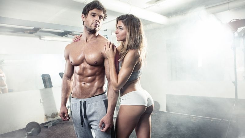 Ripped Man With Woman at the Gym